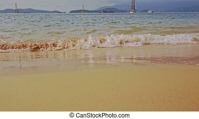 Wide Yellow Sand Beach Wave Surf against Hills Rope-way -...