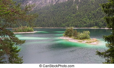 Small island at Eibsee, mountain lake in Bavaria, Zugspitze