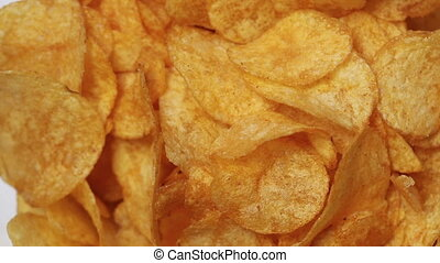 Classic potato chips rotating - Classic golden potato chips...