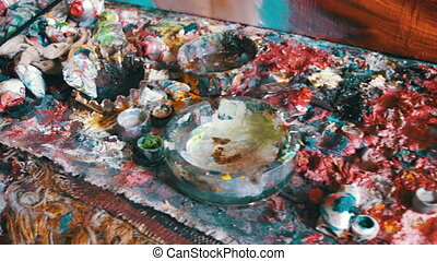Multicolored Oil Paints on the Artist's Desk in the Picture Gallery