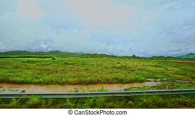 Rural Landscape Fields Grass Road Barriers against Cloudy...