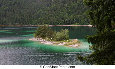 Small island at Eibsee, mountain lake in Bavaria, Zugspitze...