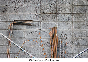 Steel Rebar with brick wall background