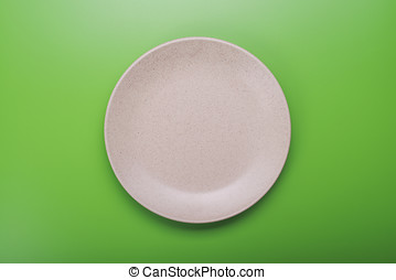 plate on green background