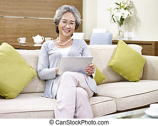 senior asian woman relaxing at home