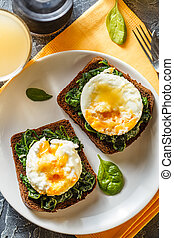 Healthy sandwich with spinach and poached eggs - Two...