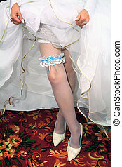 wedding garter on leg from the bride