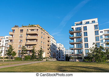 White and brown apartment houses in Berlin - Modern white...