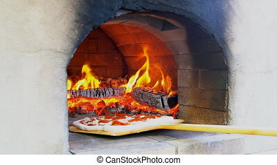 Flaming Hot Wood Fired Pizza Baking an Oven - Flaming Hot...