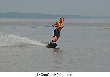 Young Man Riding a Wakeboard in Maine's Casco Bay - Young...