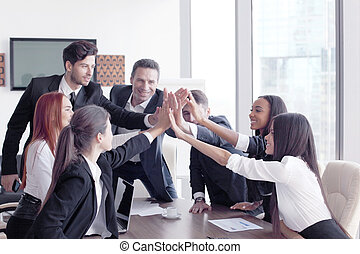Business team making high five