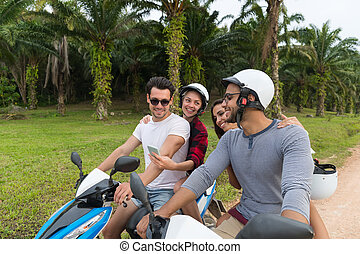 Two Couple Riding Motorbike, Young Man And Woman Travel On...