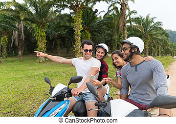 Two Couple Riding Motorbike, Young Man And Woman Using Cell...