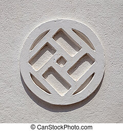 Pattern on the wall in the shape of a swastika - Sri Lanka -...