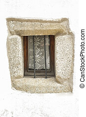 Old window with knitting courtain, at downtown street,...