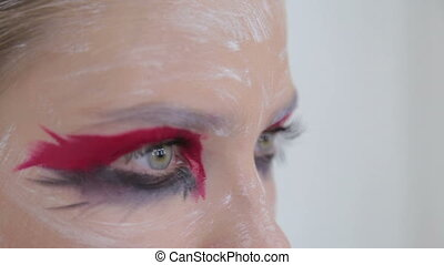 Close up shot of teen girl's eyes with creative unusual...