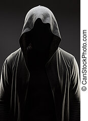 man in the hood over grey background