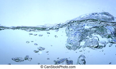 water bubbles rising from the depths in slow motion.