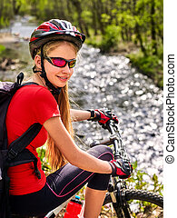 Bikes bicyclist girl rides bicycle mountains. Woman on vehicle mountaineering .