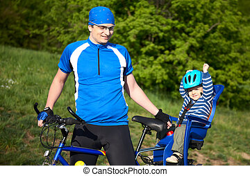 father with son in bicycle chair