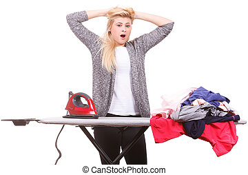 Tired woman yawning while doing ironing