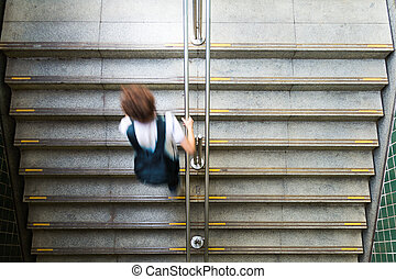 Young man leaving the train station - Young student is...