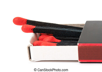 black matches in matchbox isolated on white background