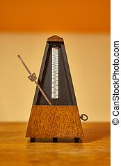 Old Classic Metronome - Classic metronome in a room with...
