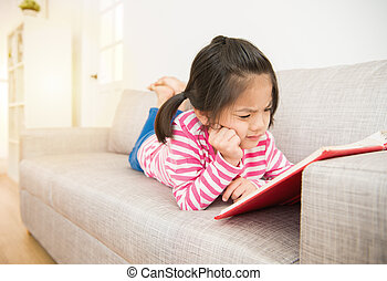 girl reading story book feel difficult