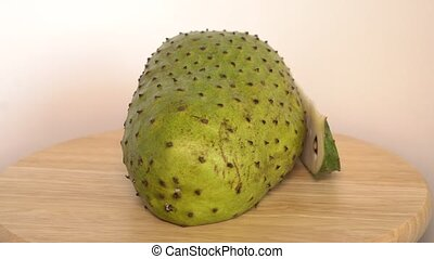 Soursop, Prickly Custard Apple with slice rotate on wooden...