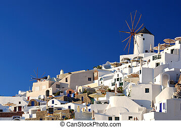 Oia windmills, Santorini, Greece - Oia is a community on the...