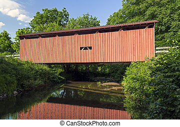 Root Covered Bridge Reflection - Built in 1878, the historic...