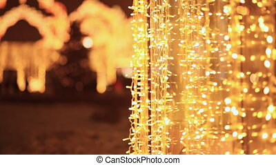 Christmas luminous garlands in the streets of the night city. Moscow. New Year theme.