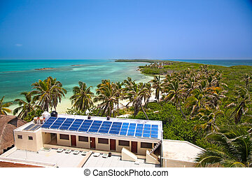 birdeye view on the beach with a building with a solar panel...
