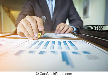 businessman hand working with new document plan and business strategy as concept.