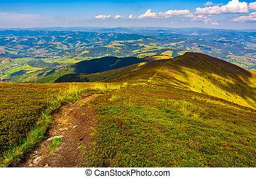 footpath down the hill through mountain ridge - summer...