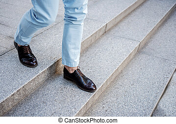 Active stylish male person going on steps - Fashionable man...