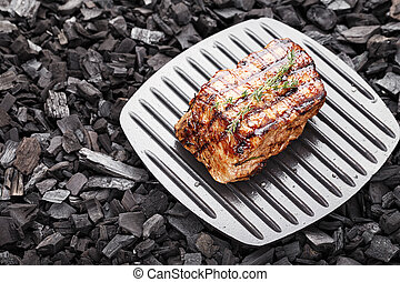Cooked steak on charcoal - Cooked grilled steak, space for...
