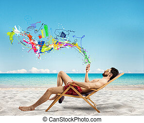 Relaxed businessman on a deckchair with his mobile phone