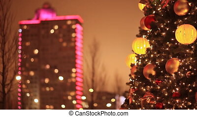 Moscow. New Arbat. Festive Christmas tree on the background of a building in Christmas illumination. Lights of night city houses. New Year theme.