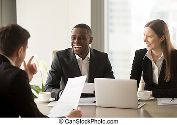 Handsome afro american businessman laughing, having fun on...