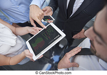 Business workers speculating about stock market