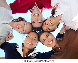 friends happy group in circle heads from below - friends...