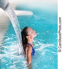 spa hydrotherapy woman waterfall jet turquoise swimming pool...