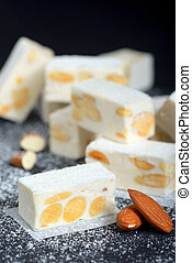 White nougat with almonds on black ardesia plate