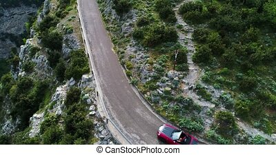 red sport convertible car moving in Amalfi coast Italy