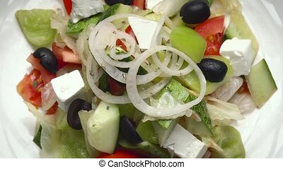 Greek Salad with tomatoes and cheese and peppers and...