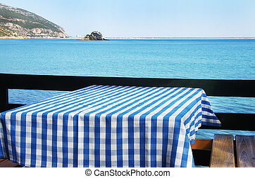 Table setting at beach restaurant, Portugal