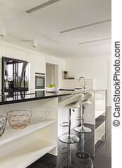 Kitchen with long island - Modern kitchen with long black...