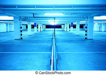 underground parking at night with blue toned